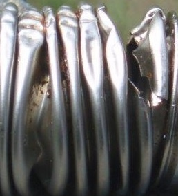 Fractured metal bellows due to overload